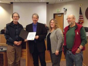 Library Advisory Board Chair Marc Komer, 2nd district Supervisor John McCowen, County Library Director Karen Horner, and LAB Vice Chair Benj Thomas receiving a proclamation celebrating 5 years of Measure A.