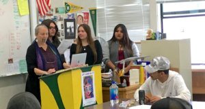 Round Valley Wailaki language teacher and Dreamstarter recipient Cheryl Tuttle with students Walter Card, Shayleena Britton, and Lourdes Downey talking to students at Willits High School this March.